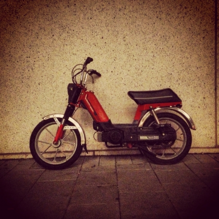 mopeds: Red moped.