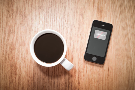 Phone set to Do Not Disturb for a peaceful coffee break.