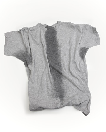 A grey t-shirt with sweat stains under sleeves and through the torso. Standard-Bild