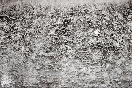 fairly: A fairly weathered stucco-like wall with a very rough texture. Stock Photo