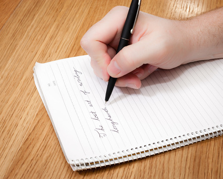 Cursive writing is demonstrated by writing, The lost art of writing longhand. Banco de Imagens