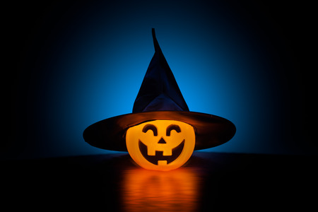 eerie: A studio isolated Jack Olantern is decorated as a witch and cast in eerie light for Halloween.