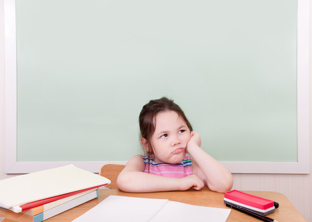 unhappiness: A young student doesnt hold back her unhappiness at whatever she is learning. Stock Photo