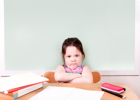 terribly: A young student is terribly unhappy about something doing on in the class.