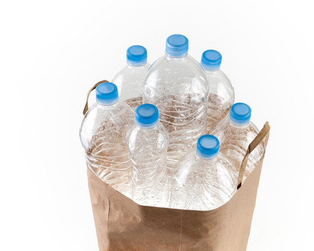 paperbag: A collection of plastic bottles for recycling in a recyclable paperbag.