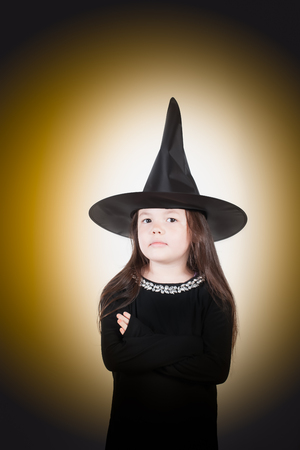 A young witch isnt impressed.