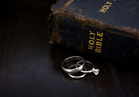 Set of Wedding Rings with the Bible photo
