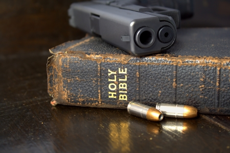 Pistol and Ammo with Bible photo