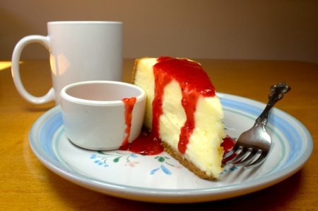 Slice of strawberry cheesecake with a cup of coffee  photo