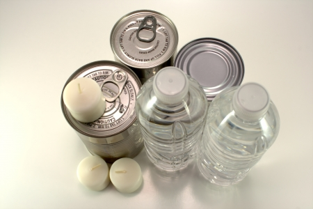 Canned goods, bottled water and candles for emergency situations