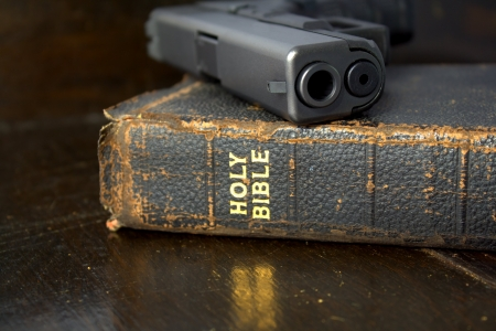 weapons: Bible with 9mm pistol