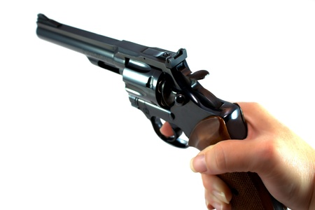 magnum: Womans hand holding a  357 revolver isolated on white