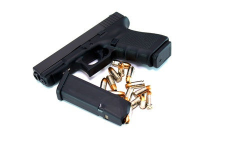 9mm pistol with extra magazine and ammunition