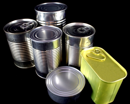 canned goods: Canned goods on black background