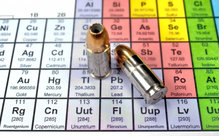 substances: Periodic table with focus on lead and 9mm bullets Stock Photo