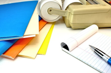 Stack of file folders with note pad and adding machine Zdjęcie Seryjne