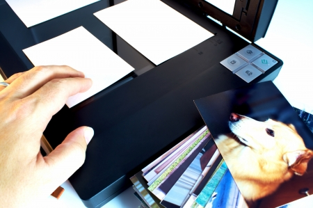scanned: Male scanning photos to preserve memories