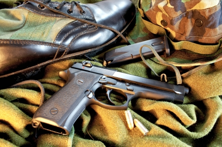 Close up of military gear and 9mm pistol Stockfoto