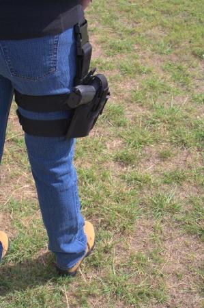 holster: Female wearing pistol leg holster