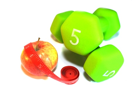 Apple with measuring tape and weights isolated on white photo