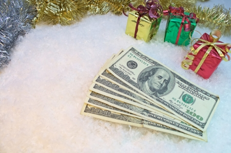 Seven one hundred dollars bills representing the cost of three small gifts and inflation Stok Fotoğraf - 16712541