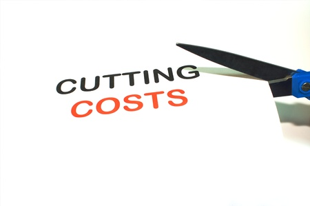 A pair of scissors representing cost cutting measures due to slow economy
