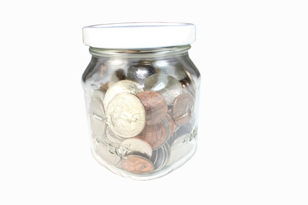 Glass jar representing a way to save change Stock Photo
