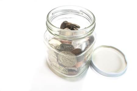 Open jar with coins inside Stock Photo