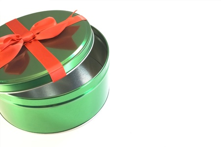 Green container with red bow isolated on white