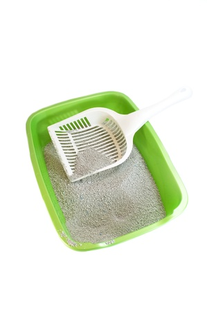 Cat litter box with scoop isolated on white