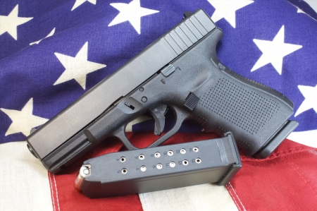 9mm pistol with 15 round clip on us flag