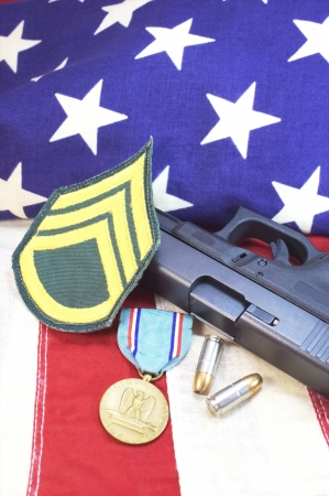 9mm pistol with ammo and medal