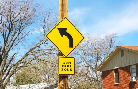 stating: Road sign stating gun free zone Stock Photo