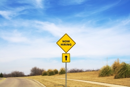 hard work ahead: Now hiring road sign pointing the way Stock Photo