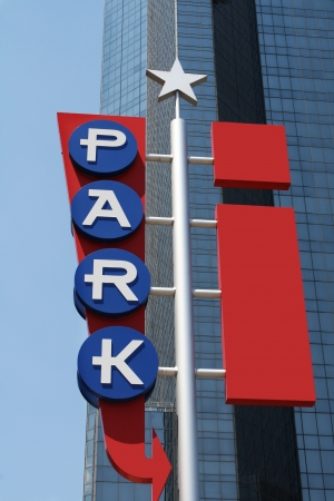 Parking sign with skyscraper background Editorial