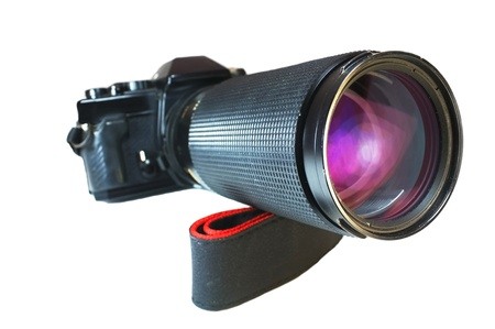 whie: Film camera with telephoto lens