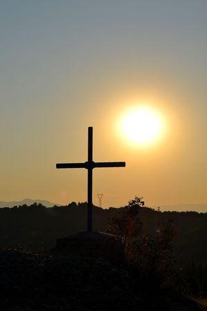 kalambaka: Cross and Sunset, silhouetted cross against the setting sun in Kalambaka, Greece