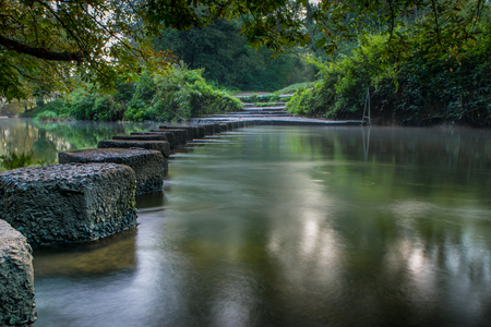 The famous stepping stones at Boxhill in Surrey England going across the famous river Mole. Stock Photo