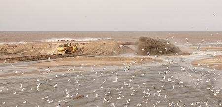 Camperduin, Noord Holland  The Netherlands - March 17th 2018 : A popular tourist destination where eight hundred thousand cubic metres of sand is being pumped onto the beach due to the sea claiming back the sandy beach.