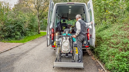 A wheelchair taxi for transporting disabled people.