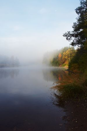 Morning mist along the river photo