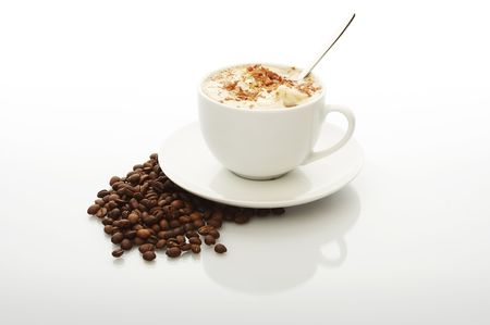 White cup of cappuccino with coffee beans Stock Photo