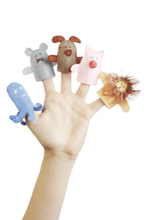 Girls hand with animal finger puppets (pig, lion, mouse, octopussy, dog)