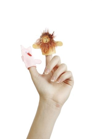 Girls hand with animal finger puppets (pig, lion) photo