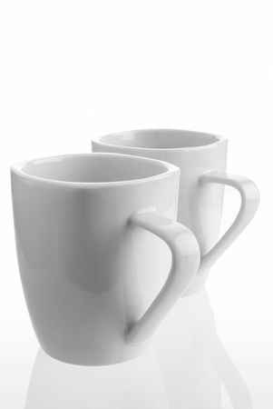 Pair of white coffee cups on white background