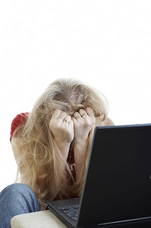 Girl having a nightmare with her laptop Stock Photo - 670176
