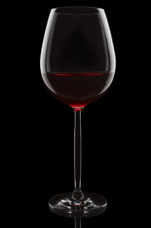 Red wine glass on the black background Stock Photo