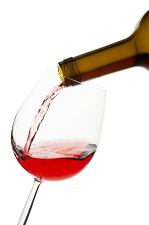 Pouring red wine to glass, clipping path included.
