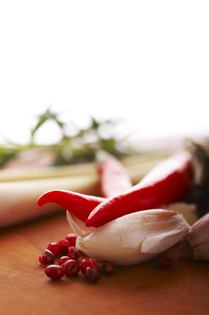 lemon grass: Thai food spices on wooden board (pepper, chili, garlic and lemon grass)