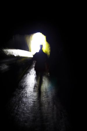 Person walking into the light